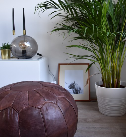 premium chocolate leather rug pouf