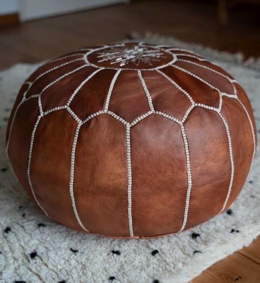 moroccan leather pouf cognac brown on rug