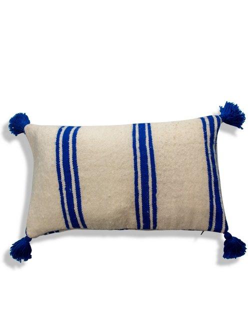 white and blue pillow pompom